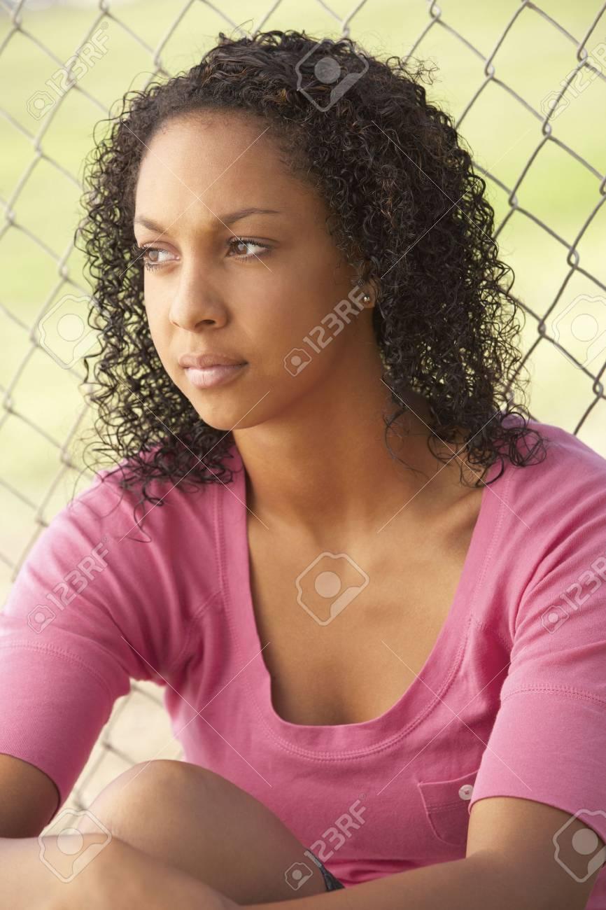 Teenage Girl Sitting In Playground Stock Photo - 6452052