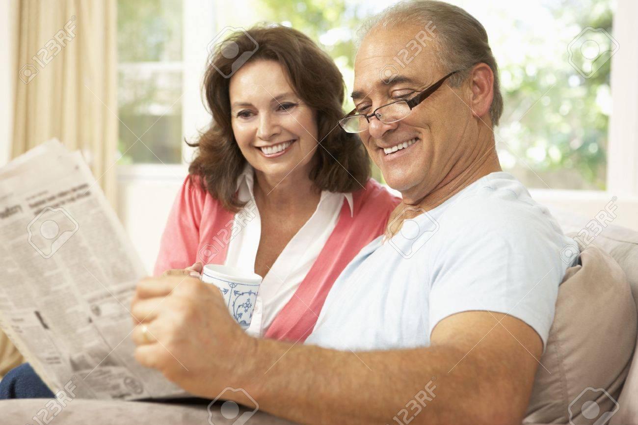 Senior Couple Reading Newspaper At Home Stock Photo - 6453410