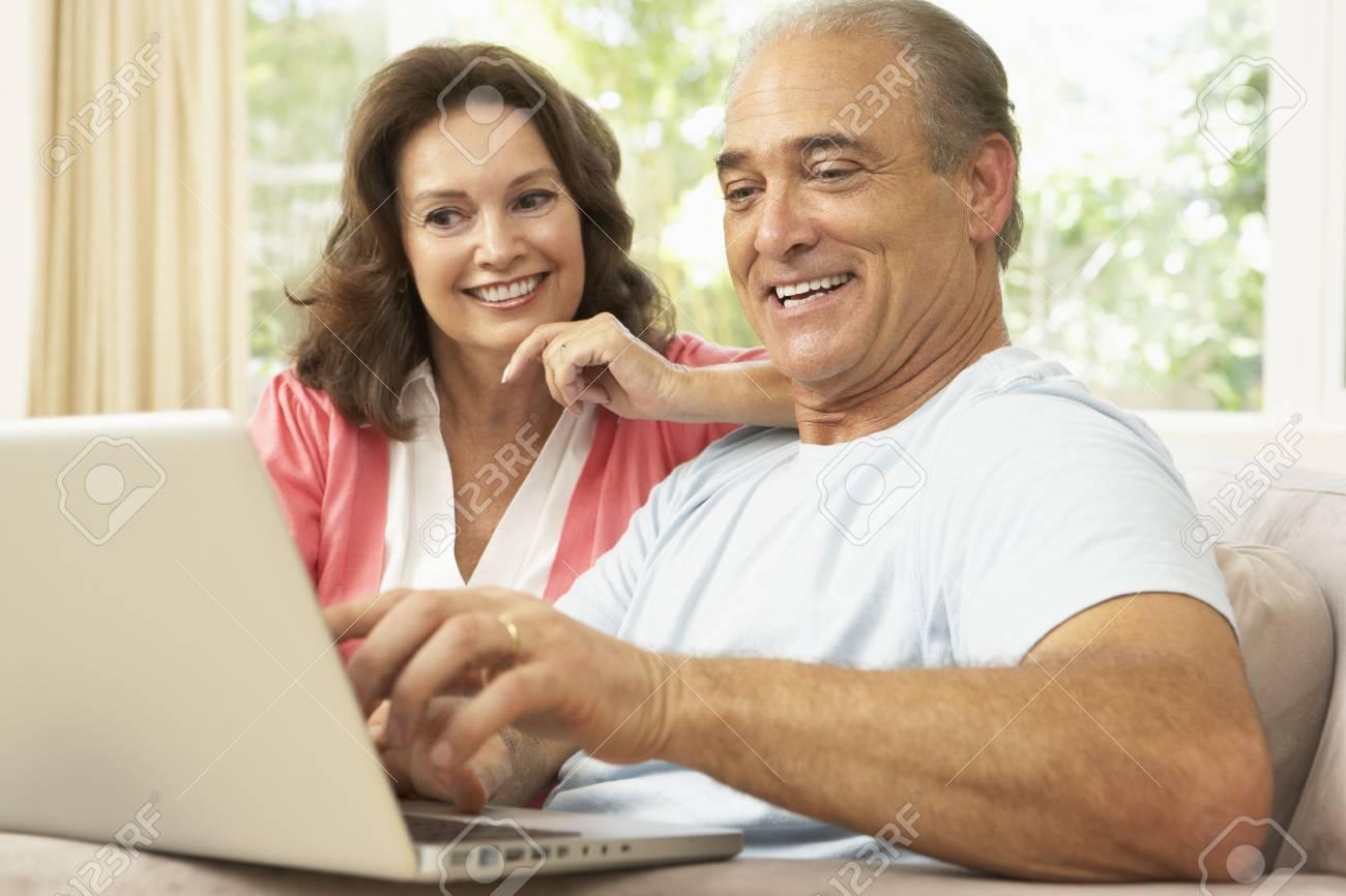 Senior Couple Using Laptop At Home Stock Photo - 6453104