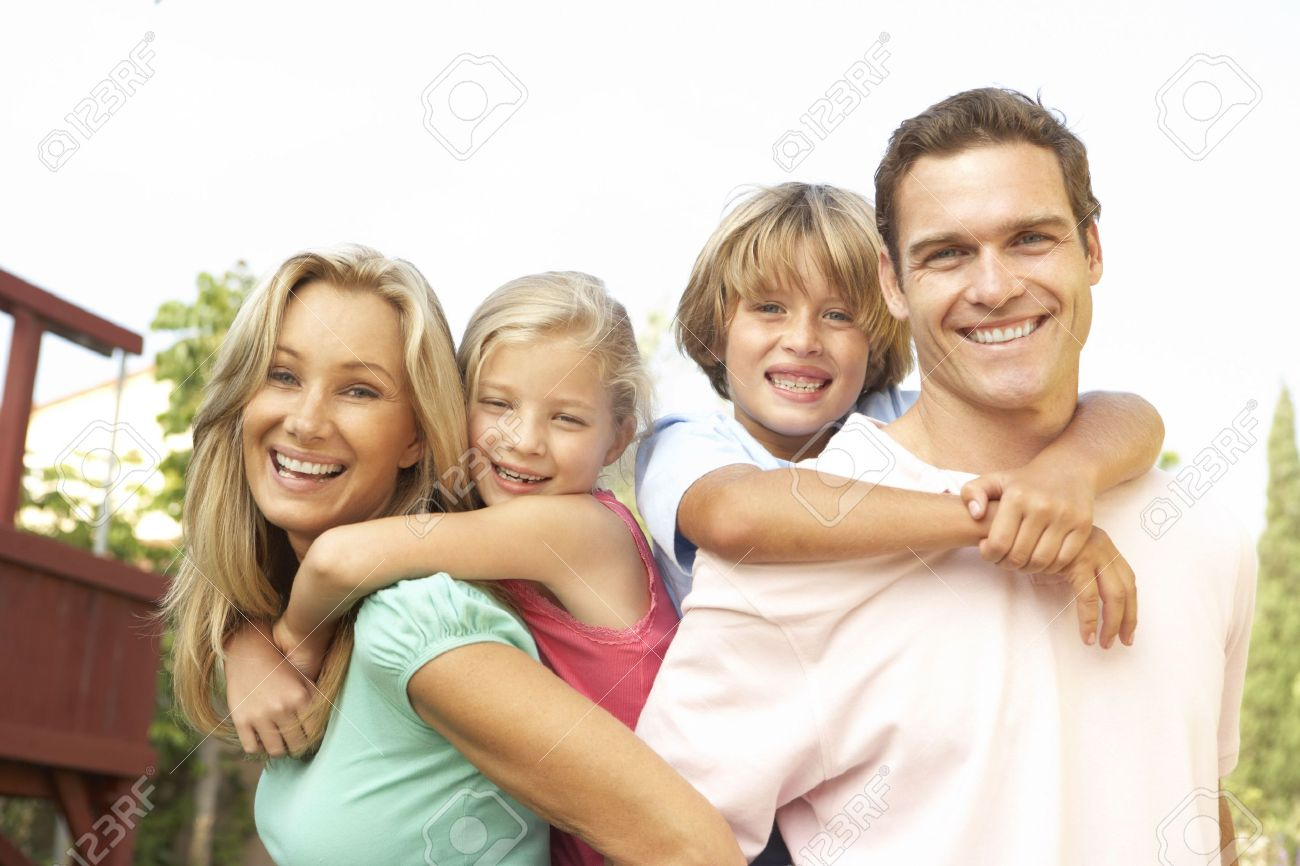 Portrait of Happy Family In Garden Stock Photo - 6452786