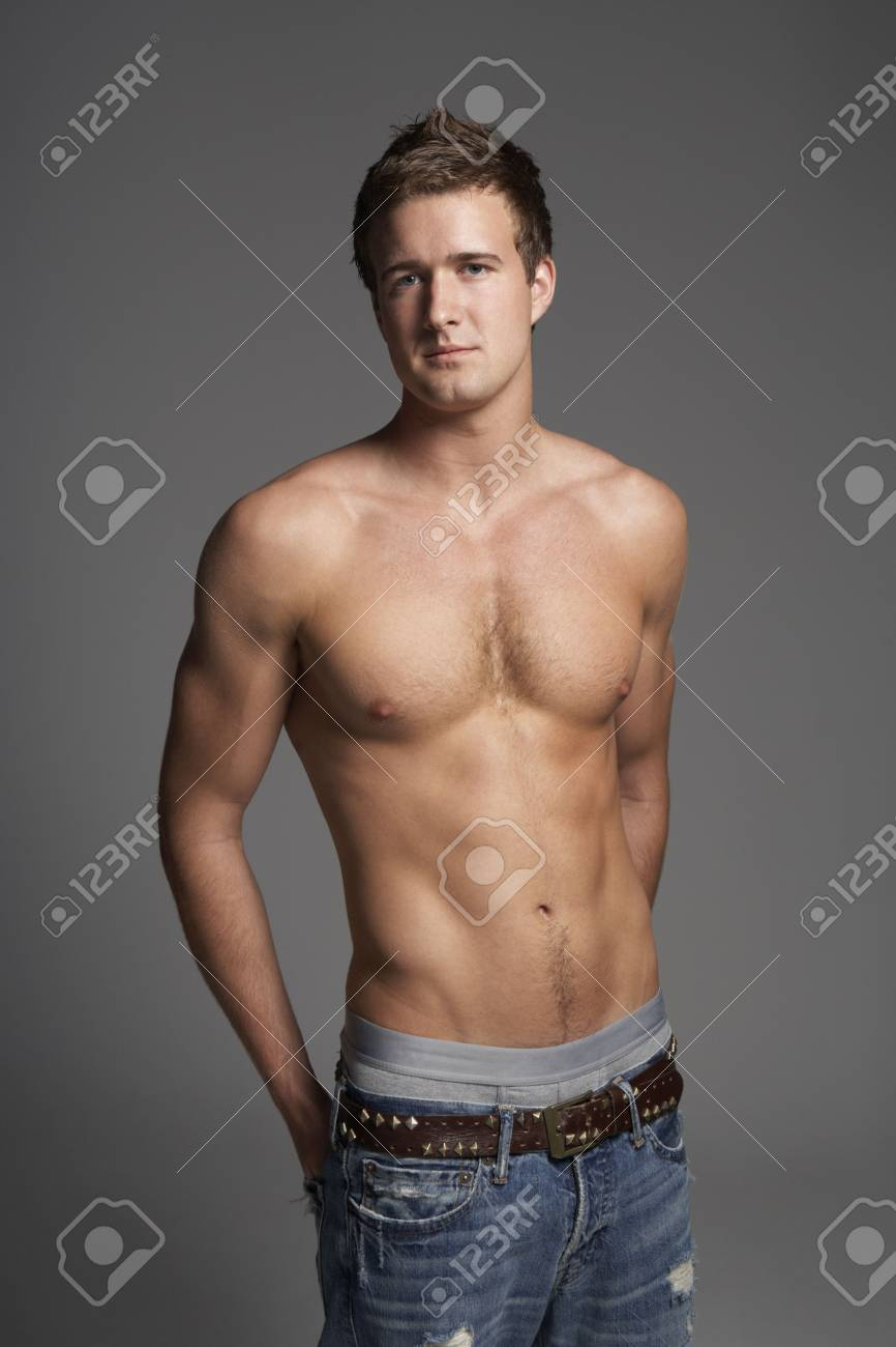 Studio Portrait Of Bare Chested Muscular Young Man Stock Photo - 6451262