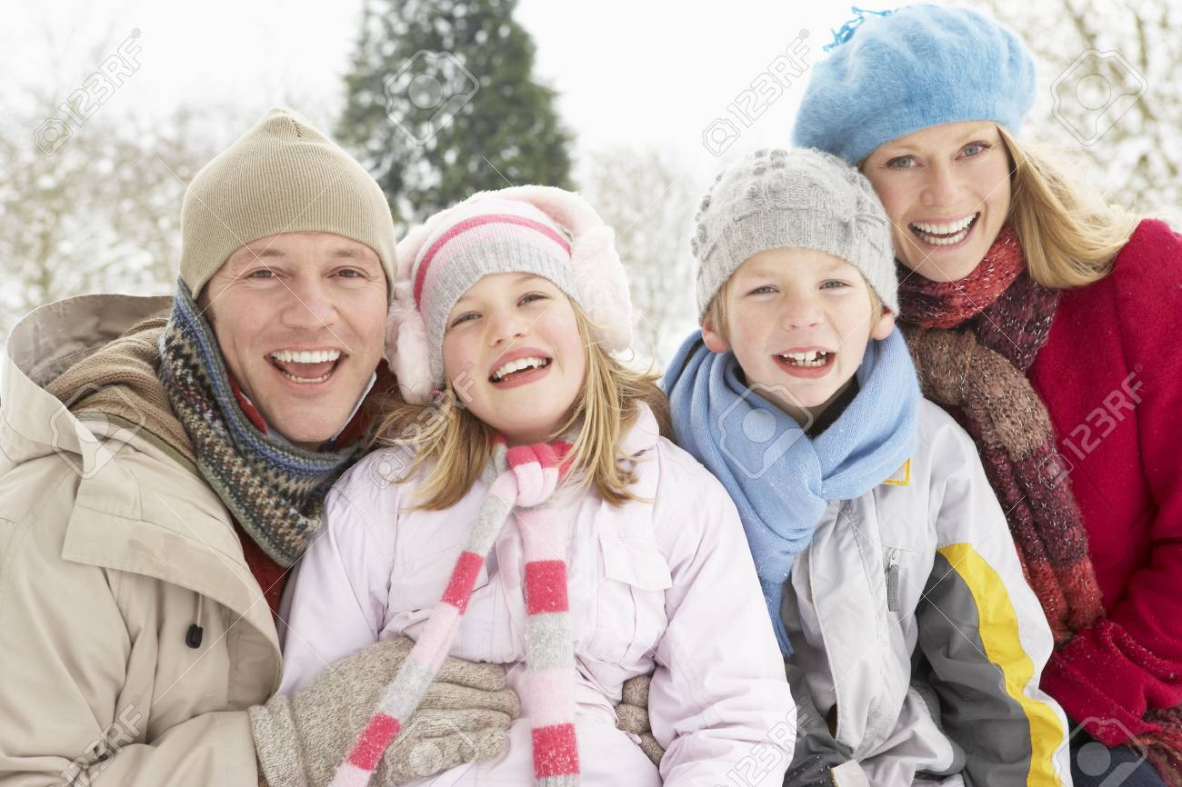 Family Sitting In Snowy Landscape Stock Photo - 6451431
