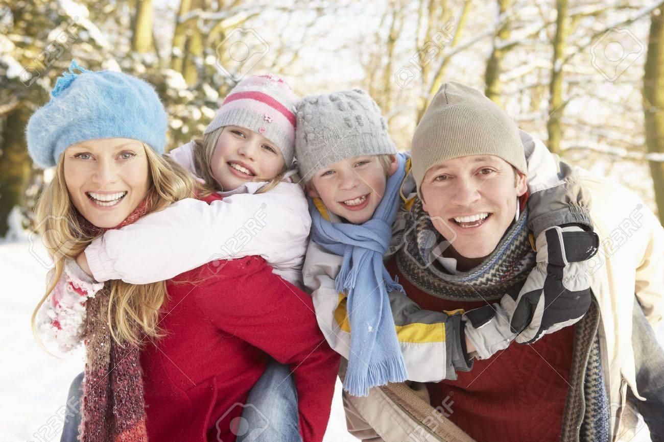 Family Having Fun Snowy Woodland Stock Photo - 6451513