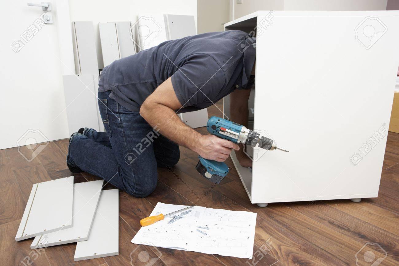 Man Assembling Flat Pack Furniture Stock Photo - 6450895