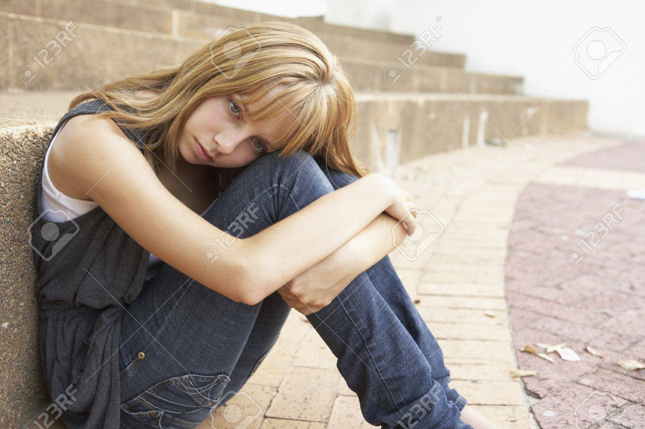 Unhappy Female Teenage Student Sitting Outside On College Steps Using Mobile Phone Stock Photo - 8108737