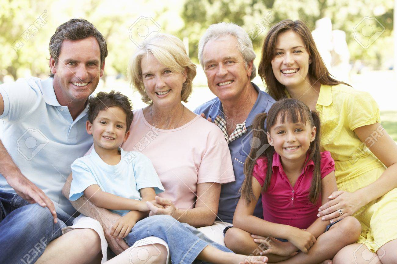 Extended Group Portrait Of Family Enjoying Day In Park Stock Photo - 8108699