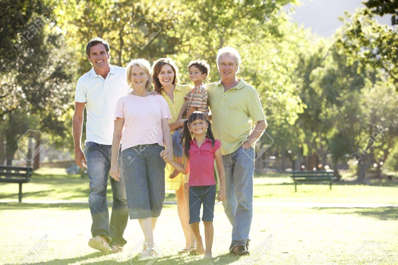 Extended Group Portrait Of Family Enjoying Walk In Park Stock Photo - 8108703