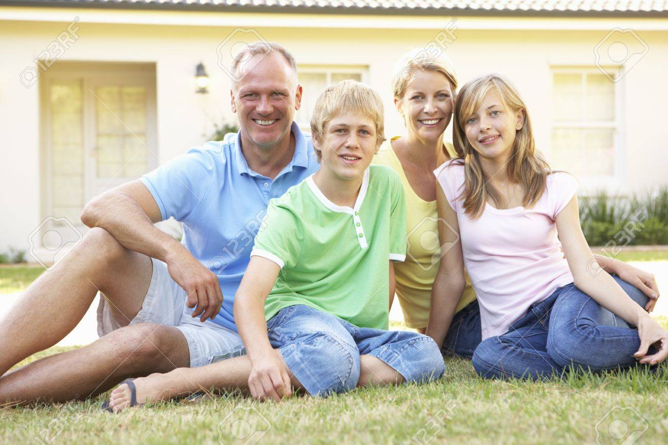 Family Sitting Outside Dream Home Stock Photo - 8108835