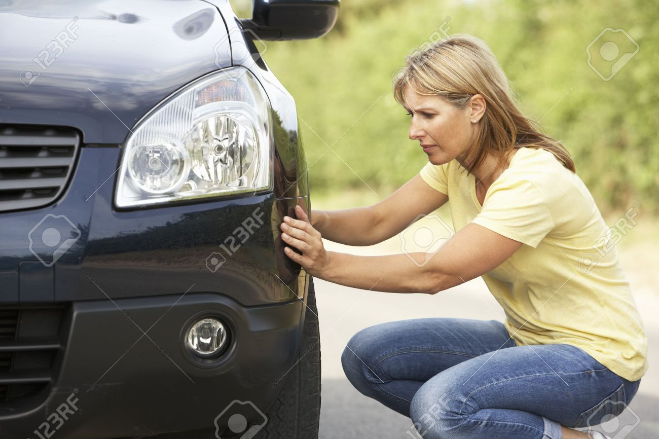 Female Driver Broken Down On Country Road Stock Photo - 8108849