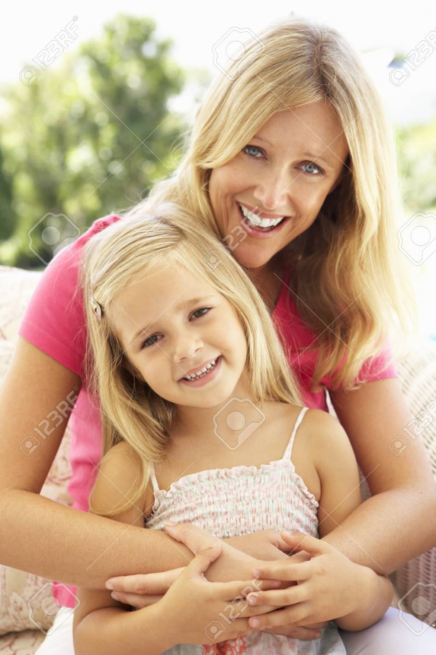 Portrait Of Mother And Daughter Relaxing On Sofa Stock Photo - 8198780