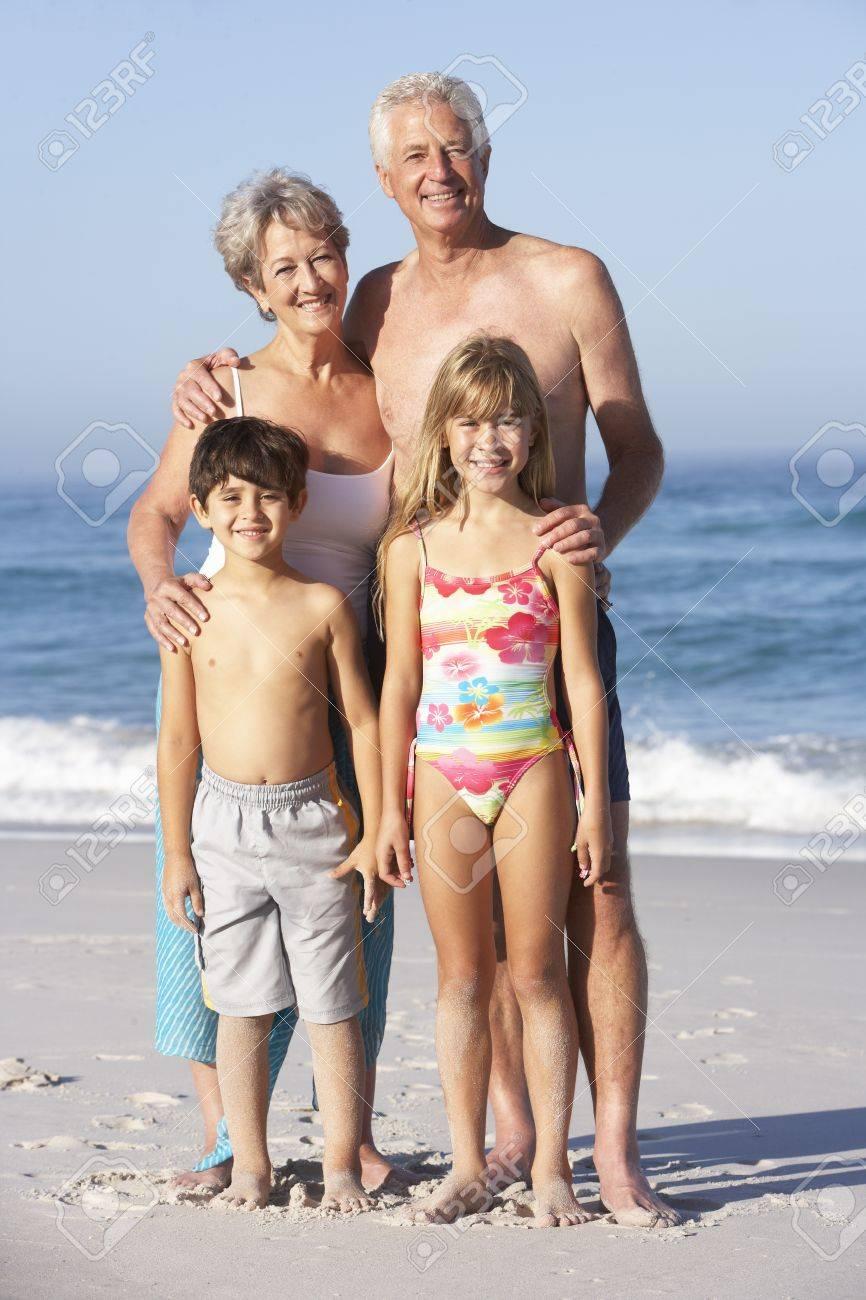 Grandparents And Grandchildren Standing On Sandy Beach Stock Photo - 8483295