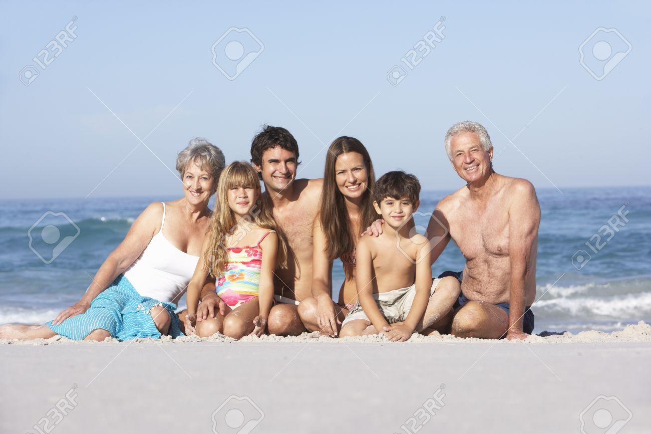 Three Generation Family On Holiday Walking Along Beach Stock Photo - 8483100