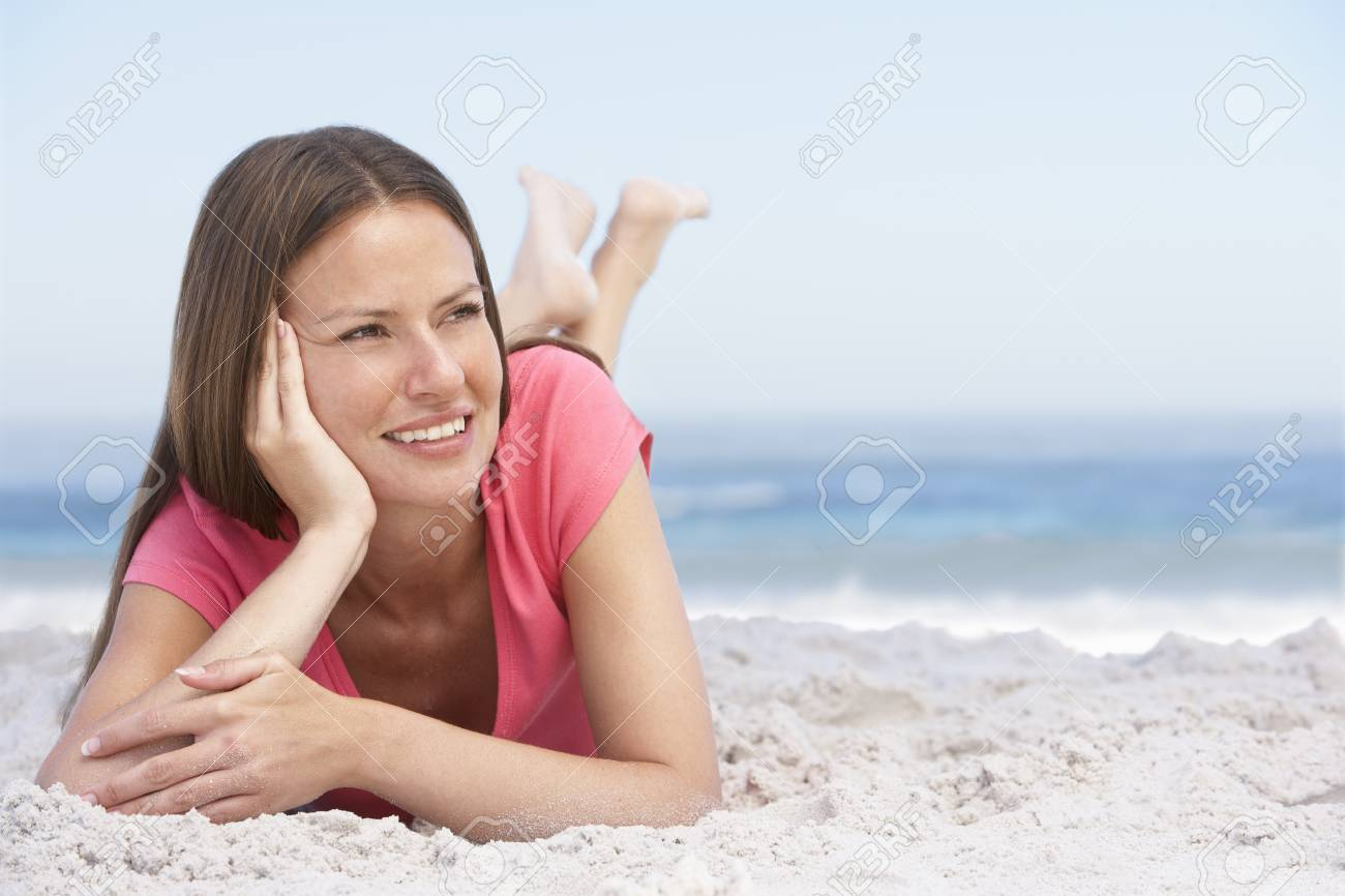 Young Woman Relaxing On Sandy Beach Stock Photo - 8482857