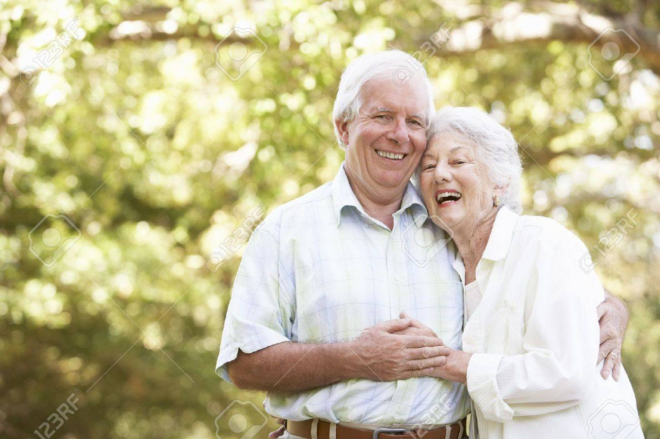 Senior Couple Walking In Park Stock Photo - 8483216