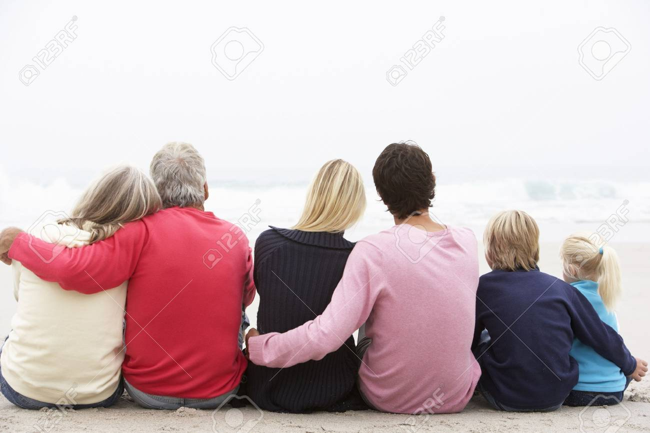 Back View Of Three Generation Family Sitting On Winter Beach Together Stock Photo - 8483169