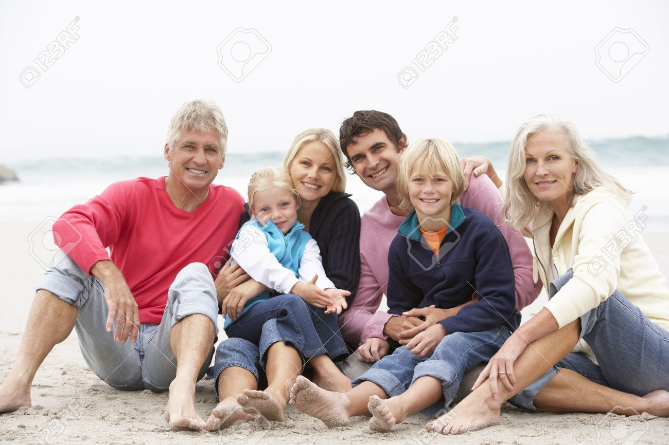 Three Generation Family Sitting On Winter Beach Together Stock Photo - 8483324