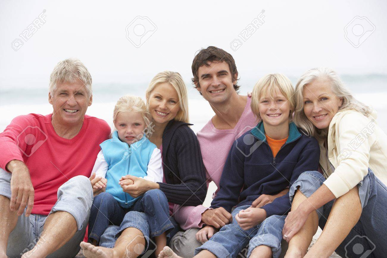 Three Generation Family Sitting On Winter Beach Together Stock Photo - 8483320