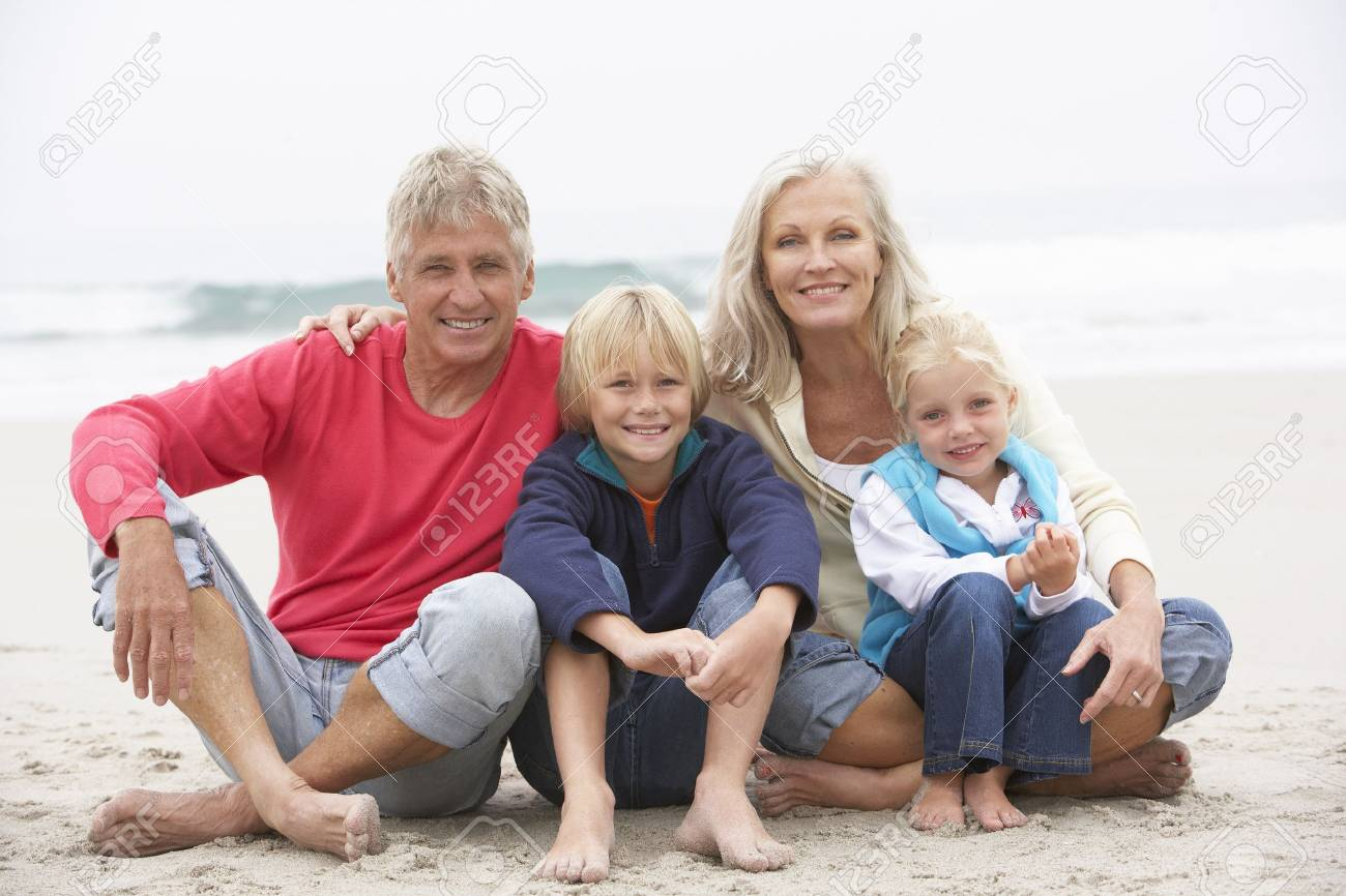 Grandparents And Grandchildren Sitting On Winter Beach Together Stock Photo - 8483300