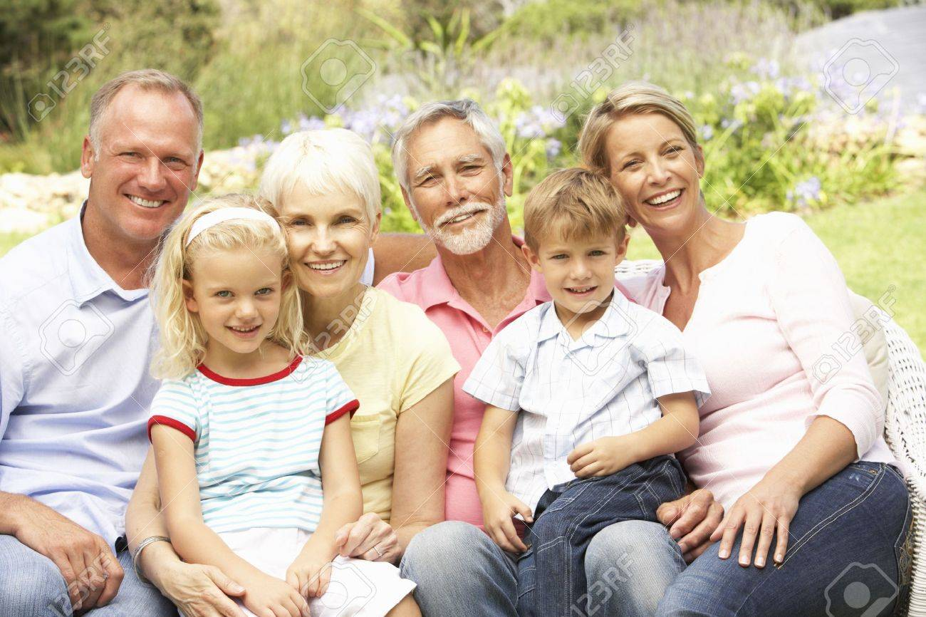 Extended Family Relaxing In Garden Stock Photo - 8483241