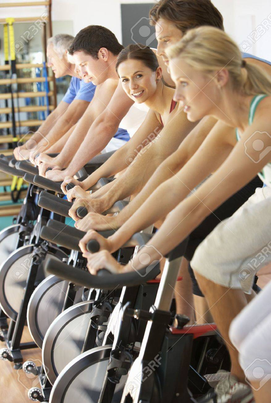 Woman Cycling In Spinning Class In Gym Stock Photo - 8503654