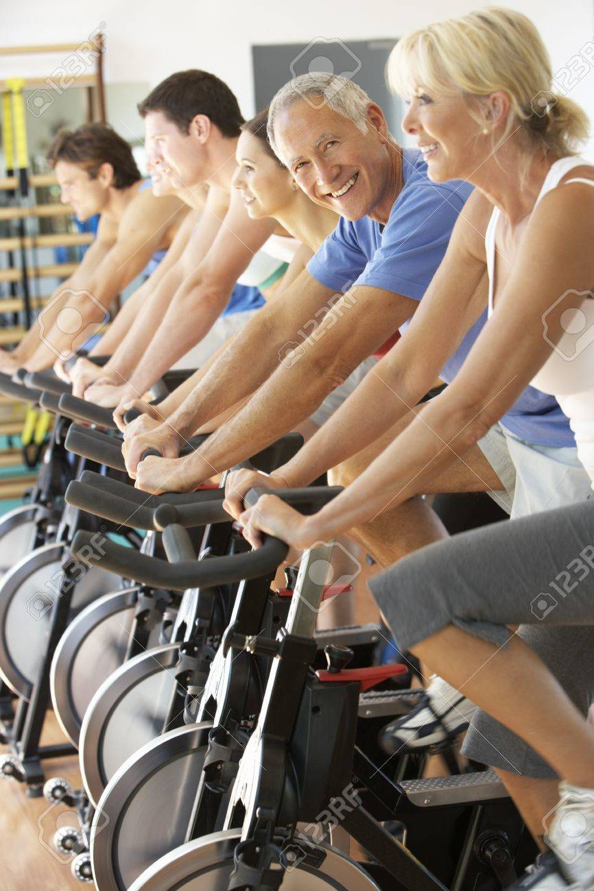 Senior Man Cycling In Spinning Class In Gym - 8505173