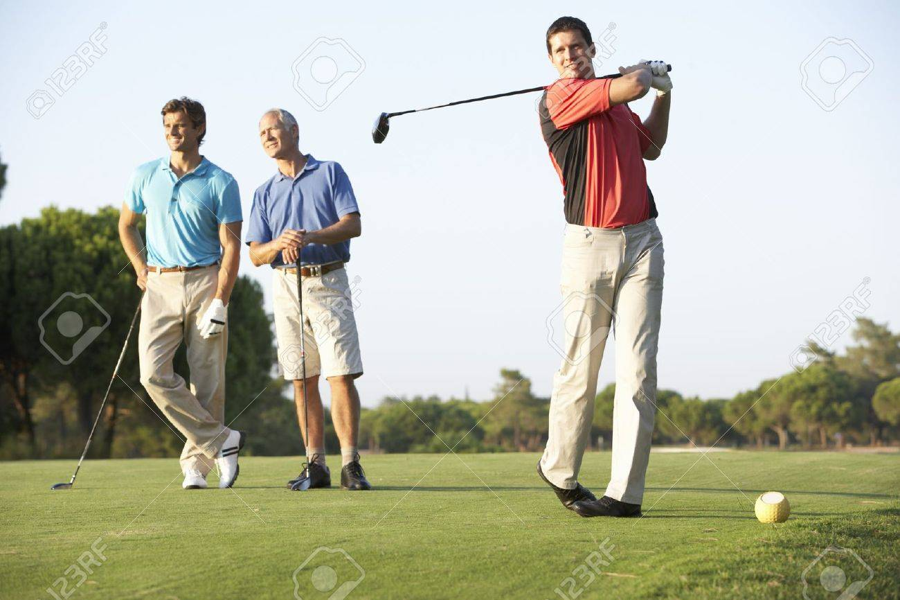 Group Of Male Golfers Teeing Off On Golf Course Stock Photo - 8505100