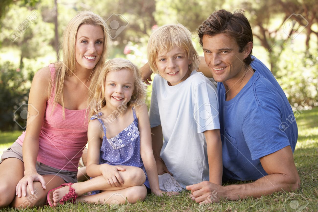 Young parents with children posing in a park Stock Photo - 8514460