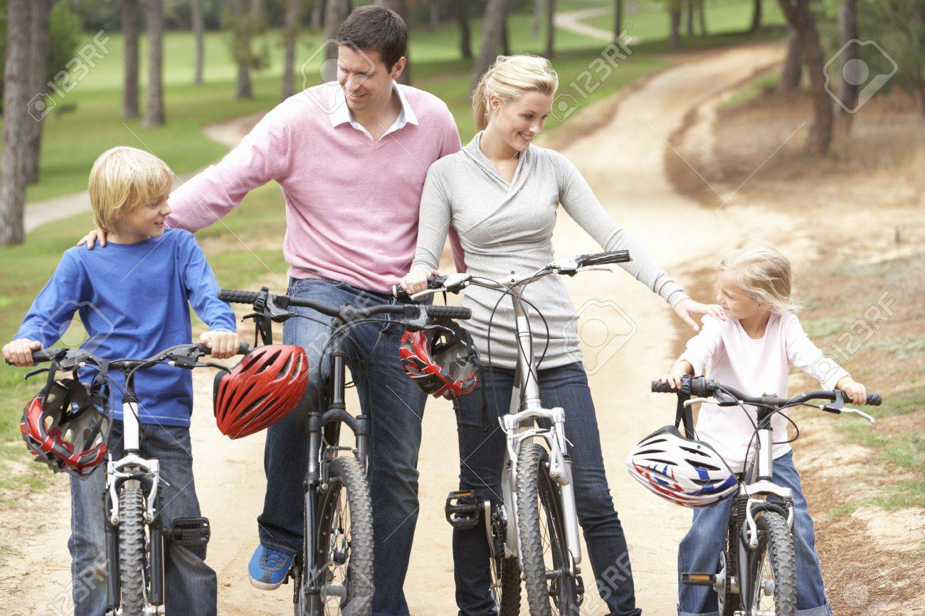 Family enjoying bike ride in park Stock Photo - 8505199