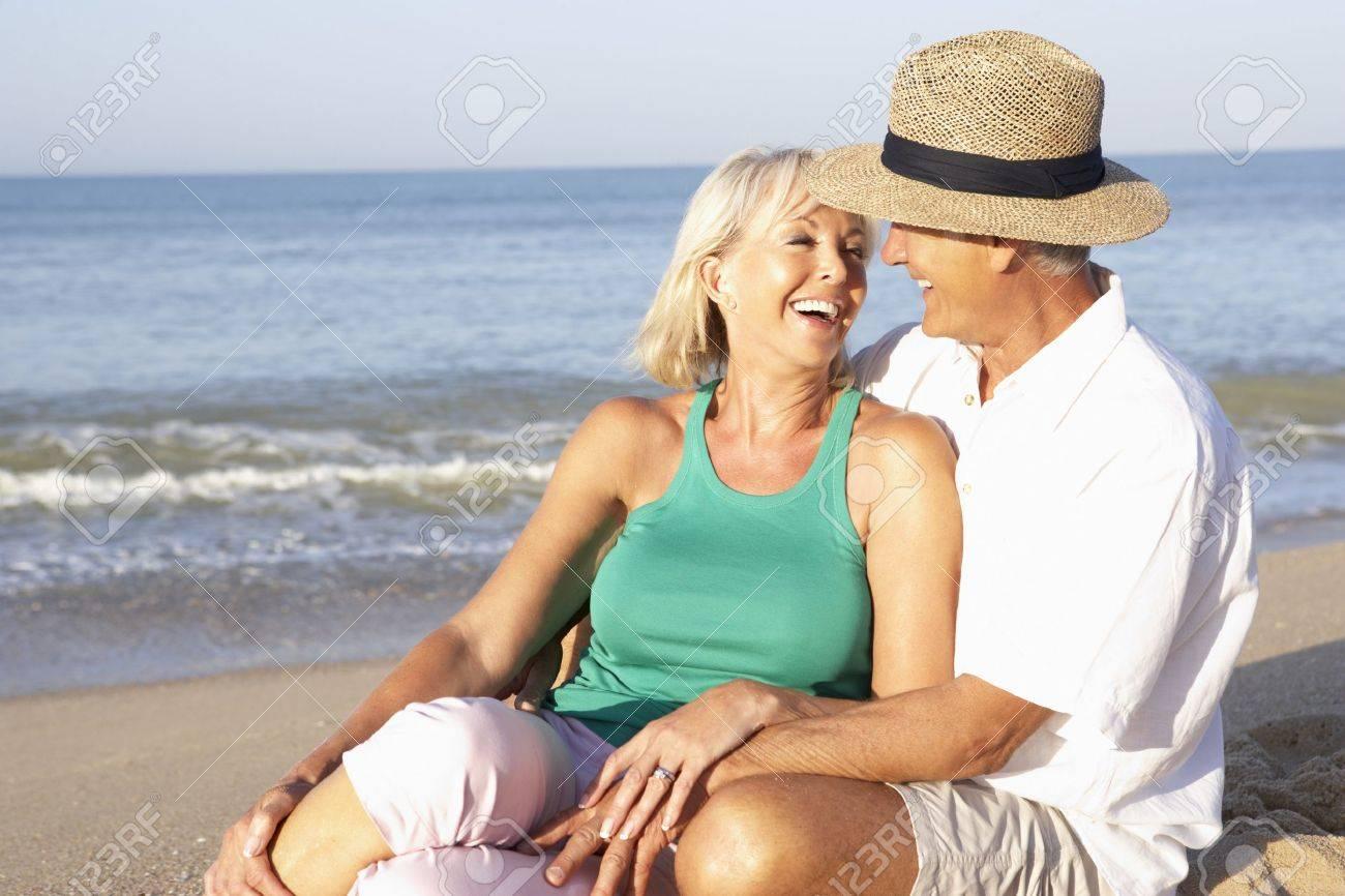 Senior couple sitting on beach relaxing Stock Photo - 9197362