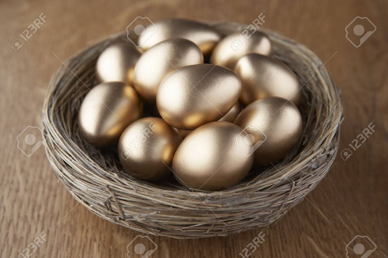 A basket of golden eggs Stock Photo - 9195322