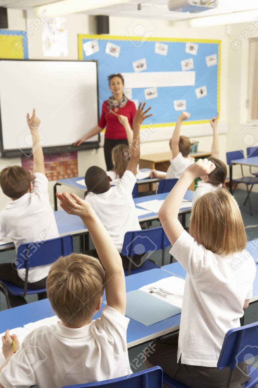 Schoolchildren Studying In Classroom With Teacher Stock Photo - 9875674