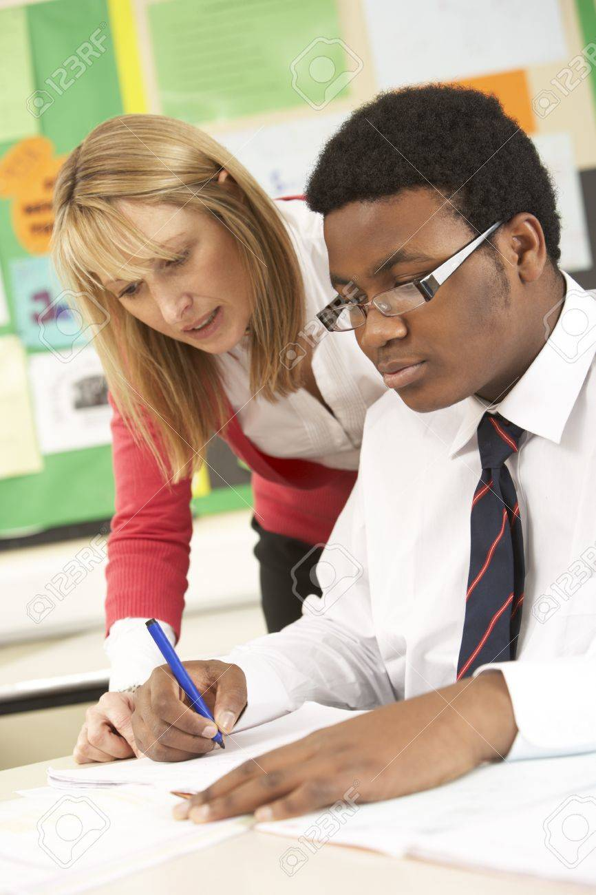 Teenage Student Working In Classroom With Teacher Stock Photo ...