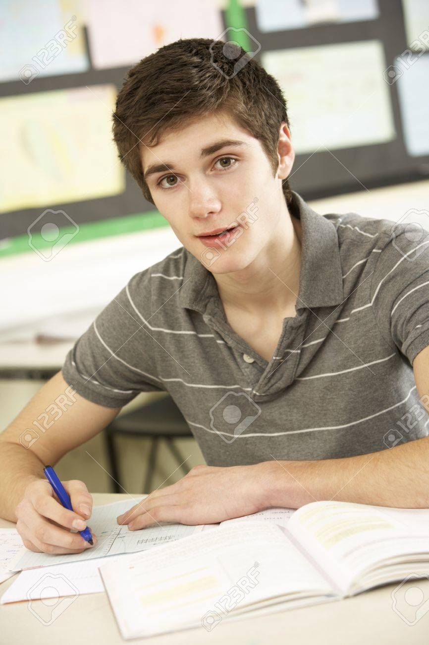 Male Teenage Student Studying In Classroom Stock Photo - 9908322