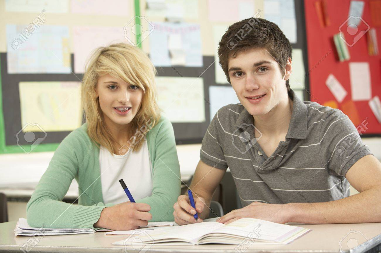 Male And Female Teenage Students Studying In Classroom Stock Photo - 9912050