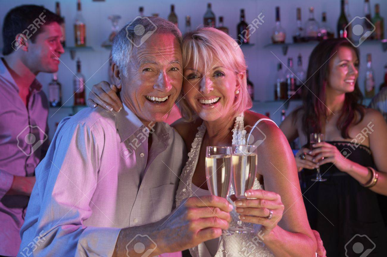 Senior Couple Having Fun In Busy Bar Stock Photo - 9911257