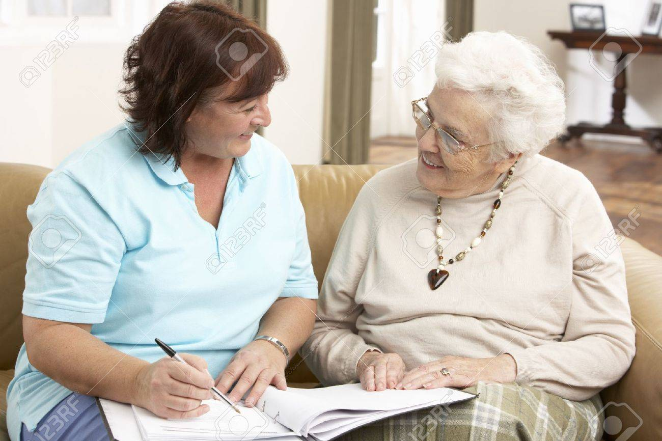 Senior Woman In Discussion With Health Visitor At Home Stock Photo - 9911338