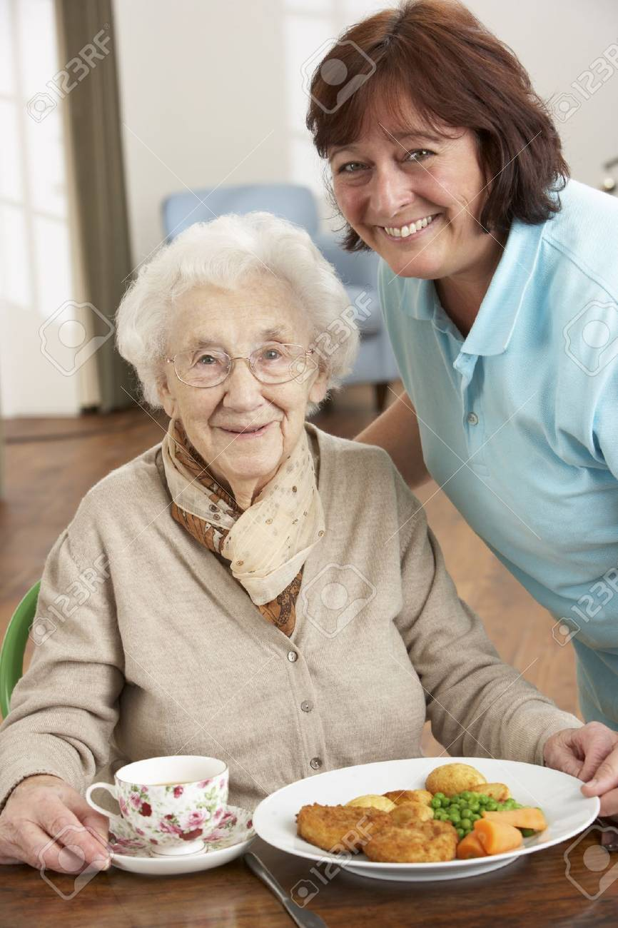 Senior Woman Being Served Meal By Carer Stock Photo - 9911143