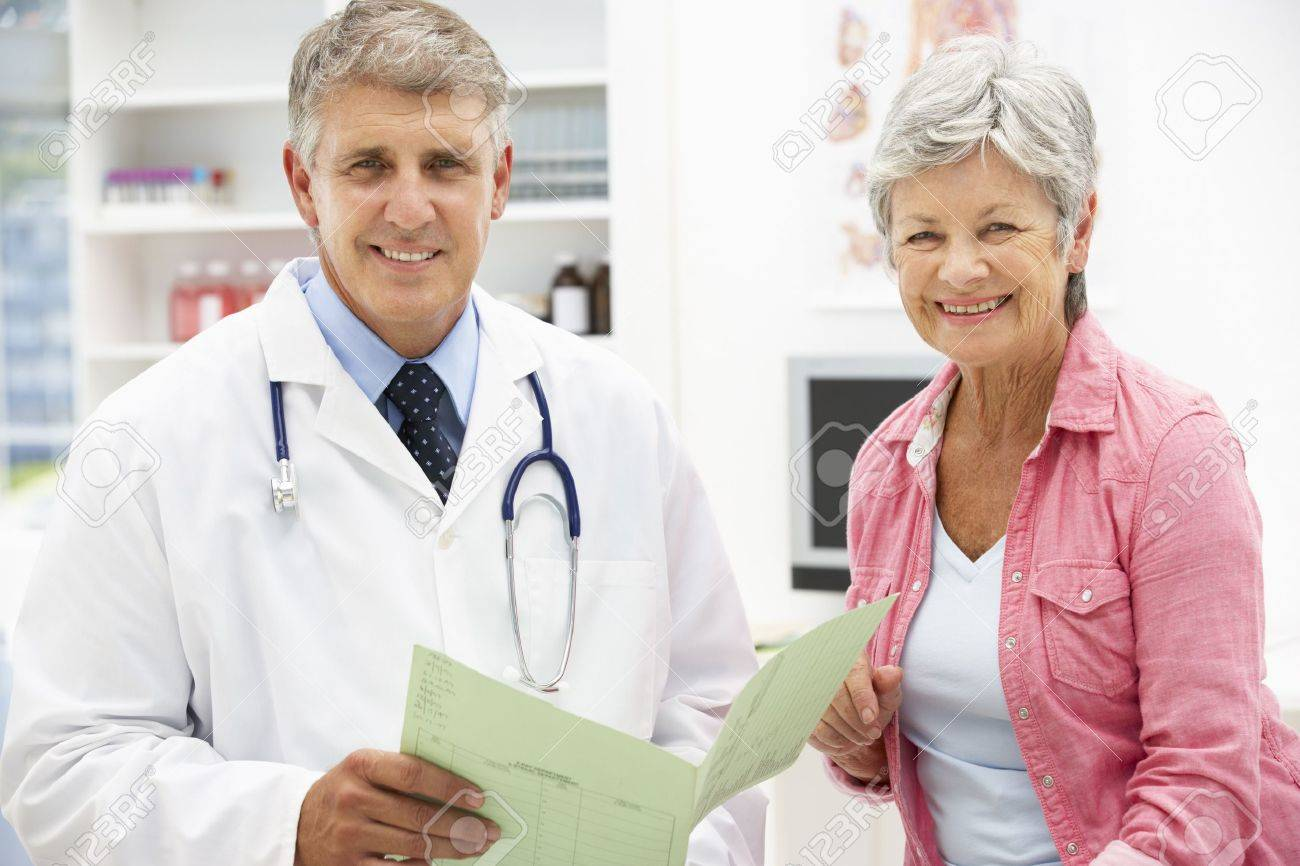Doctor with female patient Stock Photo - 11183546
