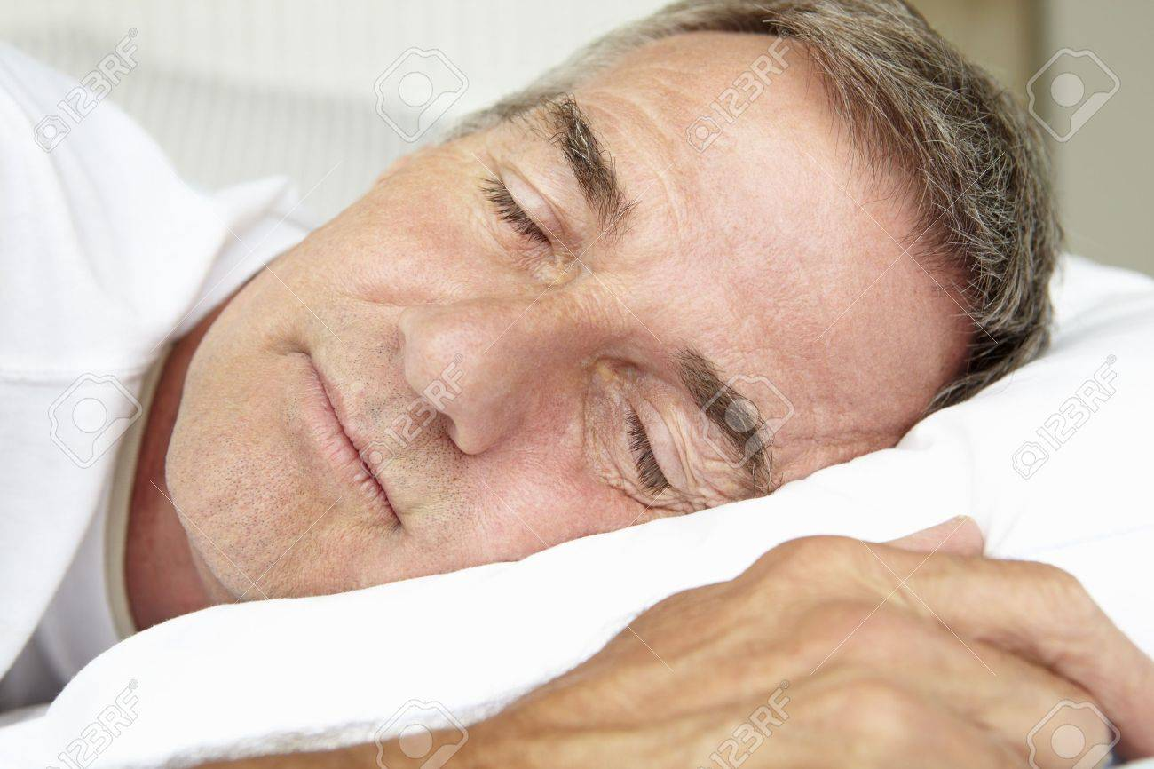 Head and shoulders mid age man sleeping Stock Photo - 11190734