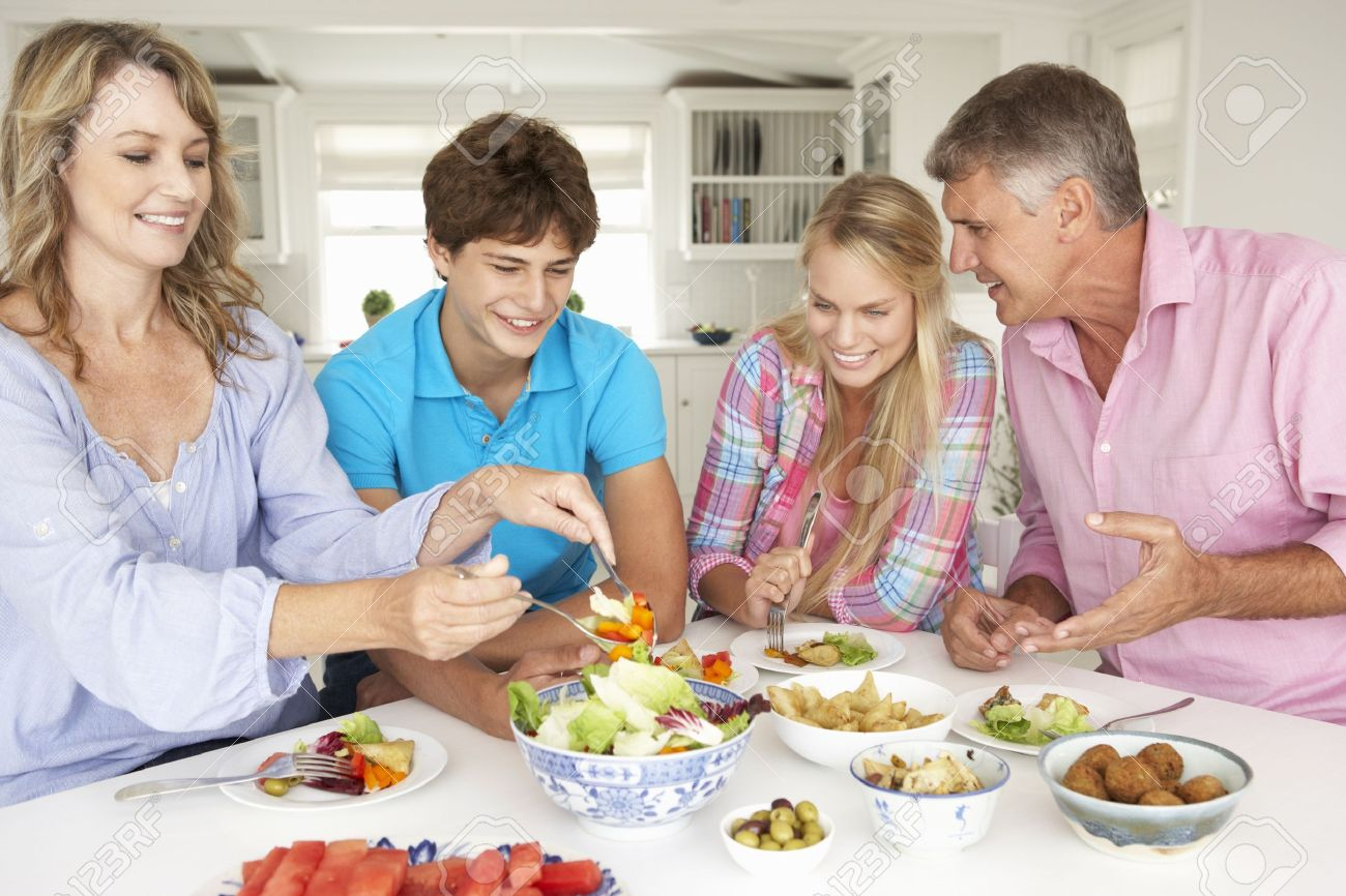 Family enjoying meal at home Stock Photo - 11190585