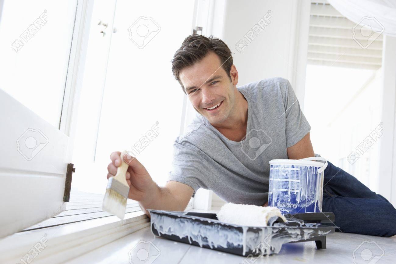 Man decorating house Stock Photo - 11190238