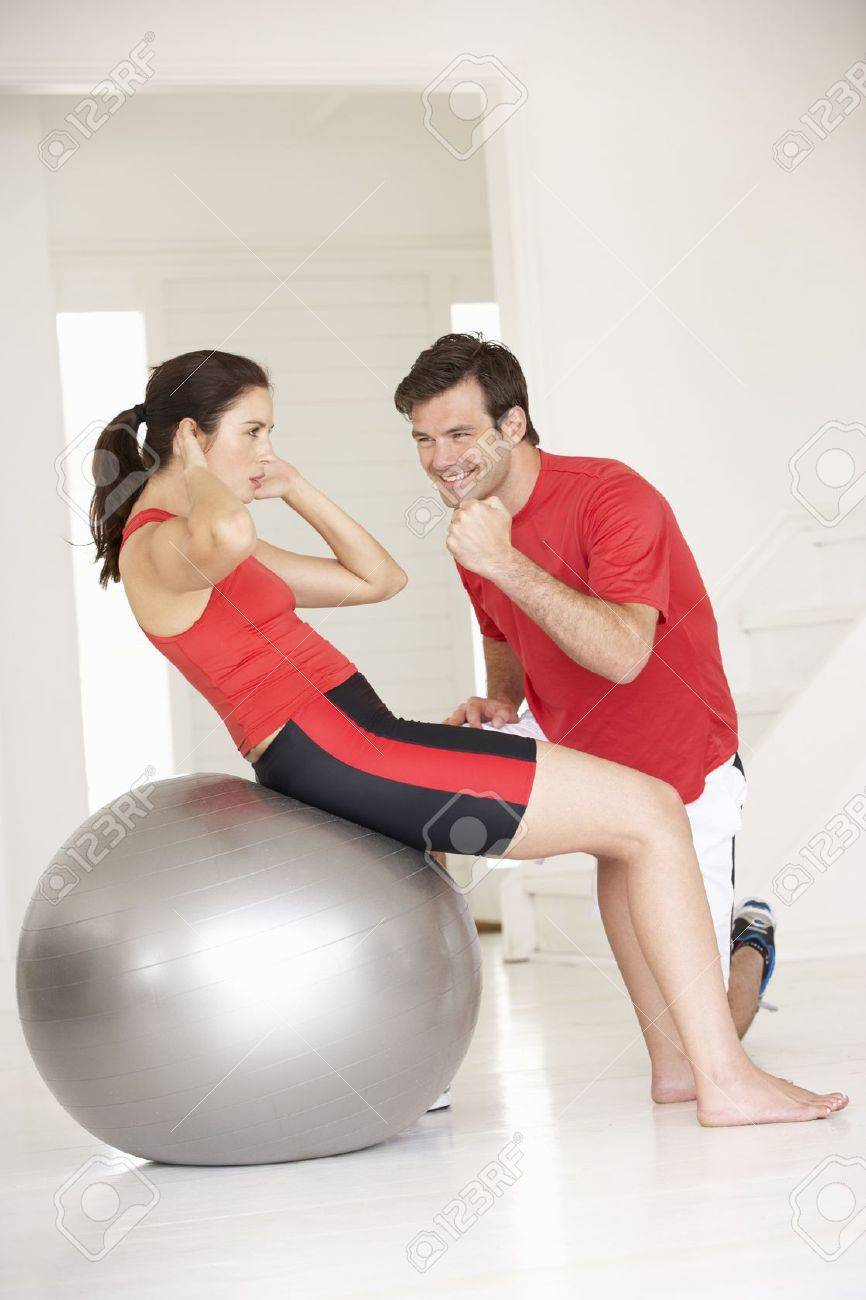 Woman with personal trainer in home gym stock photo picture and