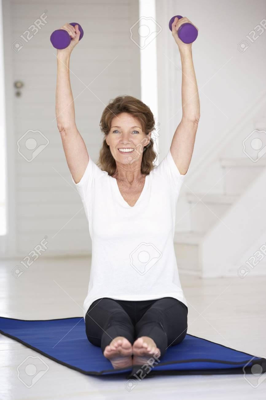 Senior woman exercising at home Stock Photo - 11210706