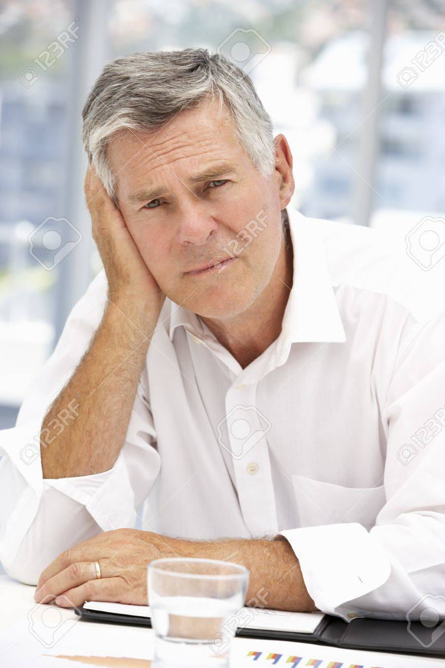 Unhappy senior businessman - 11210938