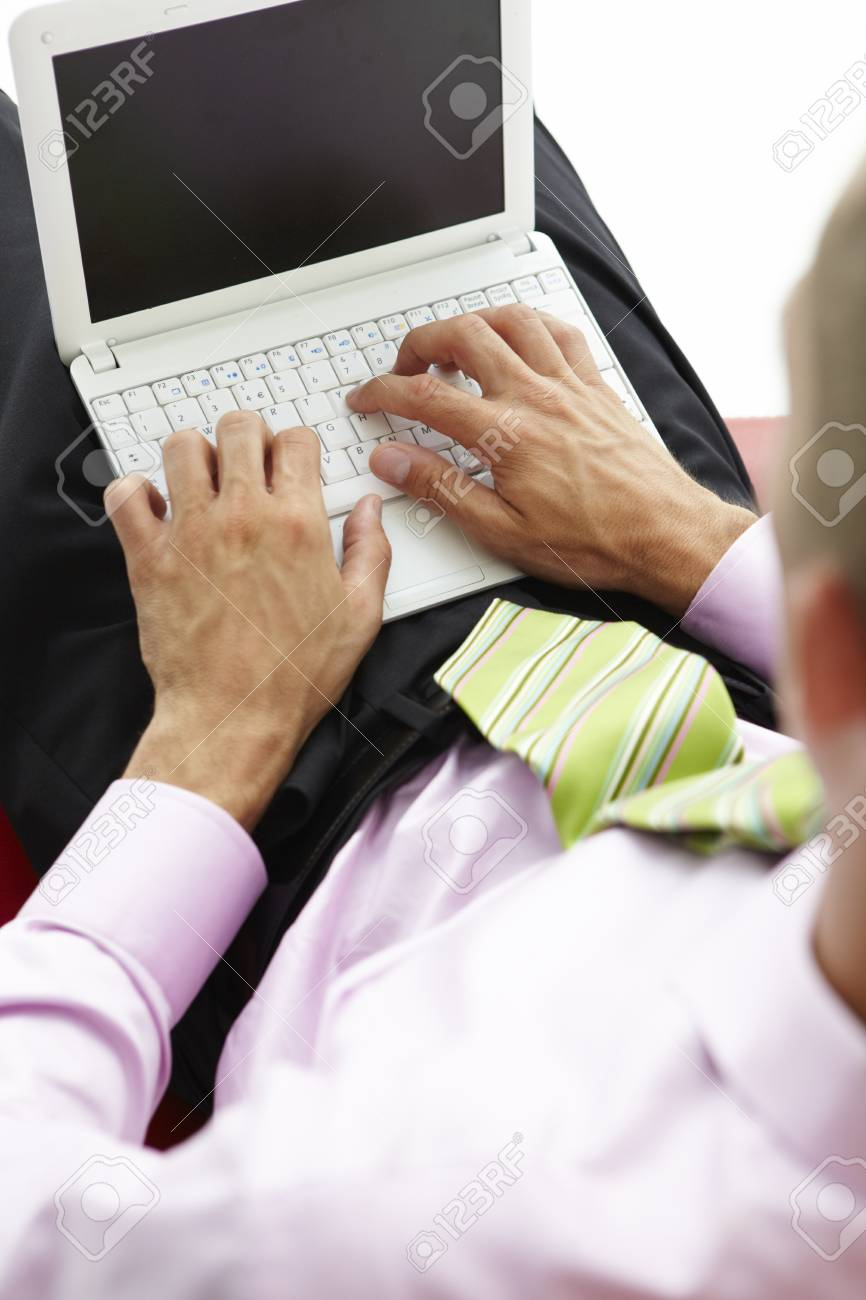 Young businessman using laptop Stock Photo - 11211383