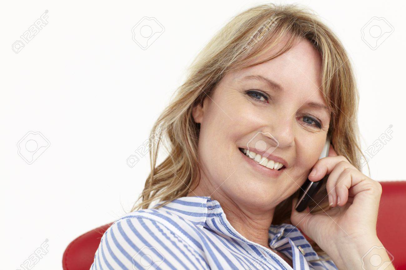 Mid age businesswoman using cellphone Stock Photo - 11217343