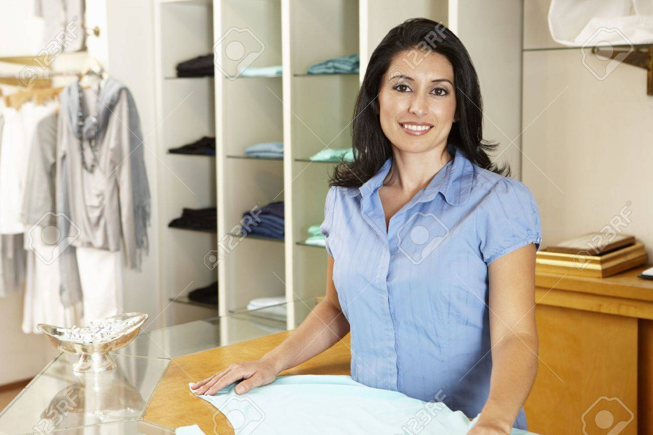 Hispanic woman working in fashion store Stock Photo - 11217480