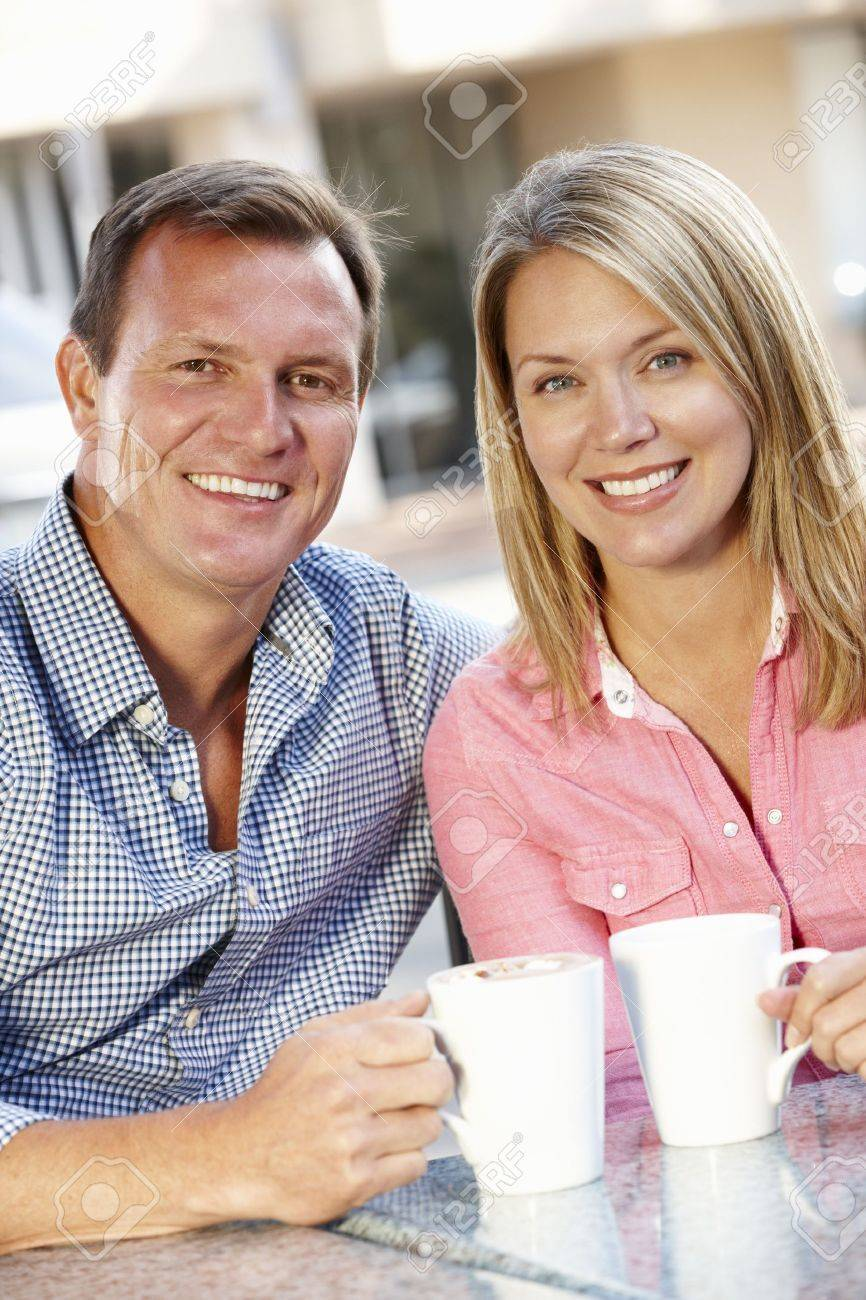 Couple sitting at sidewalk caf� Stock Photo - 11217542