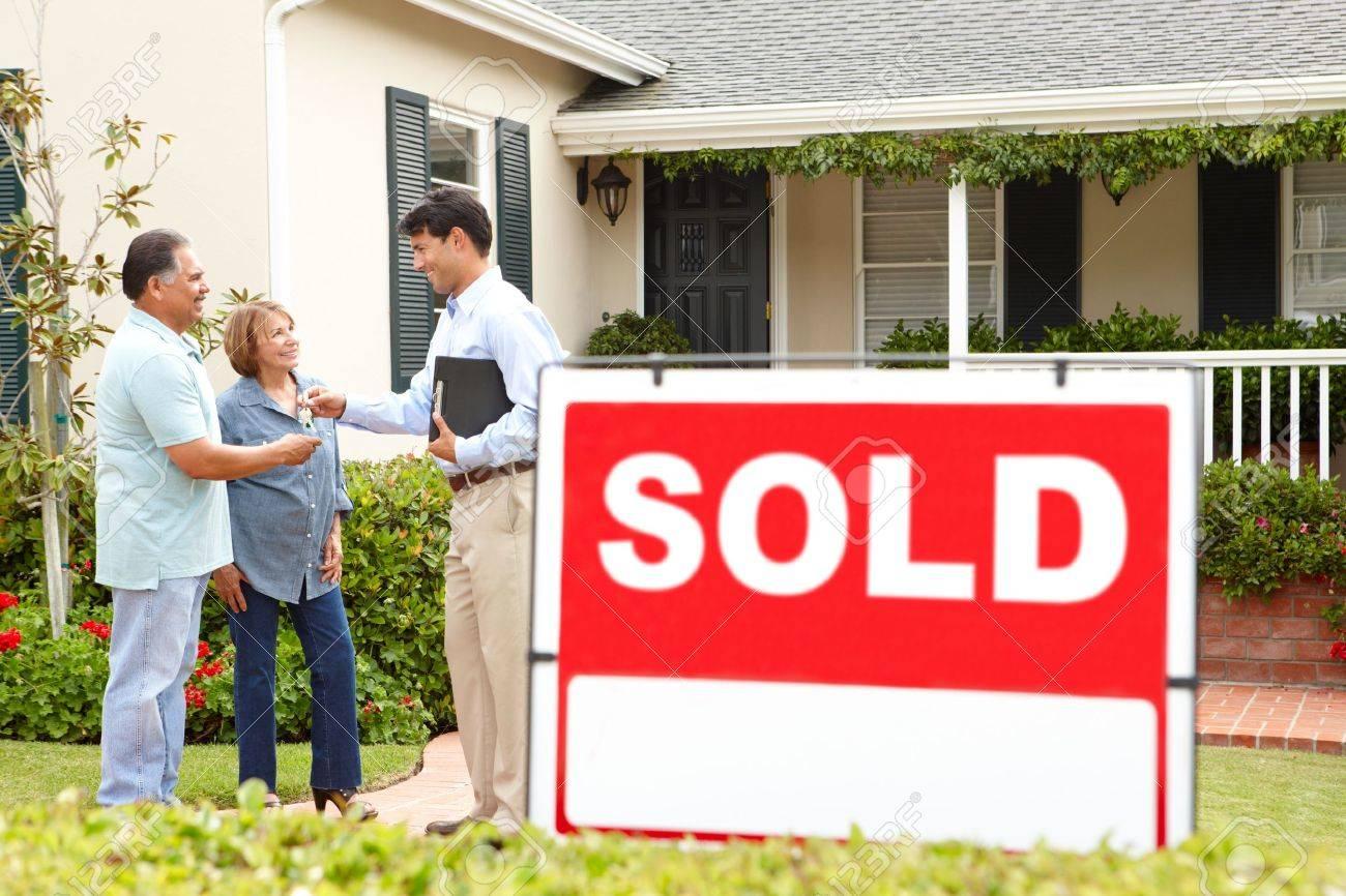 Senior Hispanic couple buying new home - 11217703