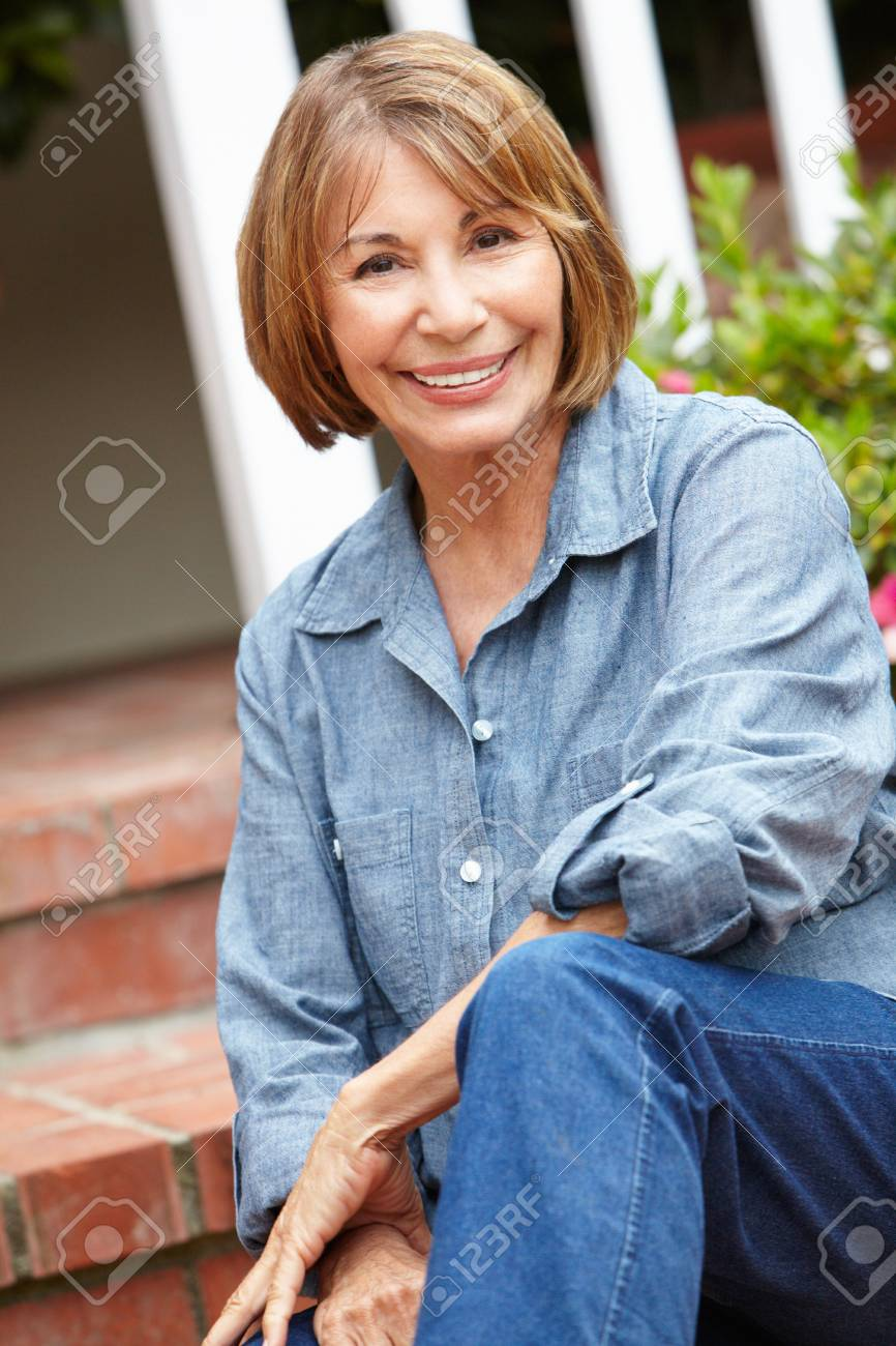 Mid age woman relaxing in garden Stock Photo - 11218048